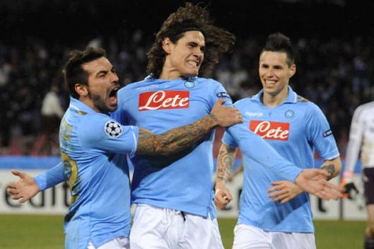 Napoli's Edinson Cavani, center, of Uruguay, celebrates with his teammates Argentina's Ezequiel Lavezzi, left, and Slovakia's Marek Hamsik after scoring, during a Champions League, round of 16, first-leg soccer match, at the Naples San Paolo stadium, Italy, Tuesday, Feb. 21, 2012. Ezequiel Lavezzi and Edinson Cavani again dampened English hopes by leading Napoli to a 3-1 win over Chelsea in an entertaining first leg of their Champions League last-16 matchup. (AP Photo/Salvatore Laporta)